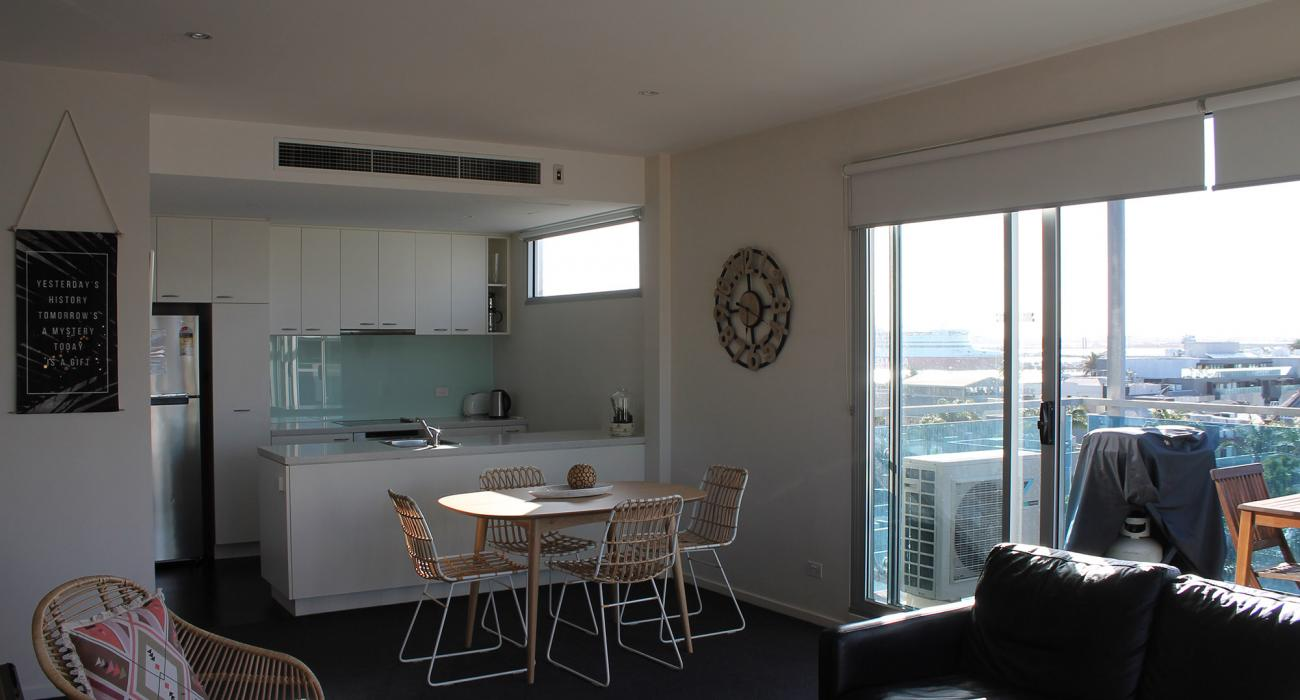 Zinc Views 501 - Port Melbourne - Living Area Looking Towards Dining and Kitchen Area b